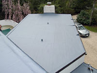 residential flat roof with acrylic membrane application photo